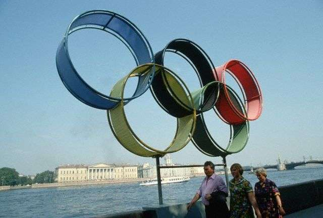 Russian Tourists Posing Below the Olympic Rings